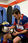 Ardmore Marist halfback Callum Cook reads the names of previous McNamara Cup winners. CMRFU Counties Power 2008 Club rugby McNamara Cup Premier final between Ardmore Marist & Patumahoe played at Growers Stadium, Pukekohe on July 26th.  Ardmore Marist won 9 - 8.