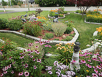 Kathy &amp; Bill Clements,<br />  1344 Michigan Avenue, <br /> 519-542-4444, <br /> clementsw32@gmail.com<br /> <br /> My yard is all perennials in full sun. The yard changes every few weeks with some flowers dying off and new flowers blooming.  There is a fountain in the front and a waterfall in the back.