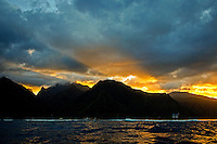 Teahupoo, Tahiti Iti, French Polynesia. Tuesday 14 August 2012. Sunrise over Teahupoo. The swell had backed off today to around 2' and an onshore NW wind made Teahupoo virtually unsurfable. Photo: joliphotos.com