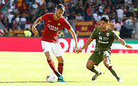Roma's Bryan Cristante, left, is challenged by Cagliari's Luca Pellegrini during the Serie A soccer match between Roma and Cagliari at Rome's Olympic Stadium, October 6, 2019. UPDATE IMAGES PRESS/ Riccardo De Luca