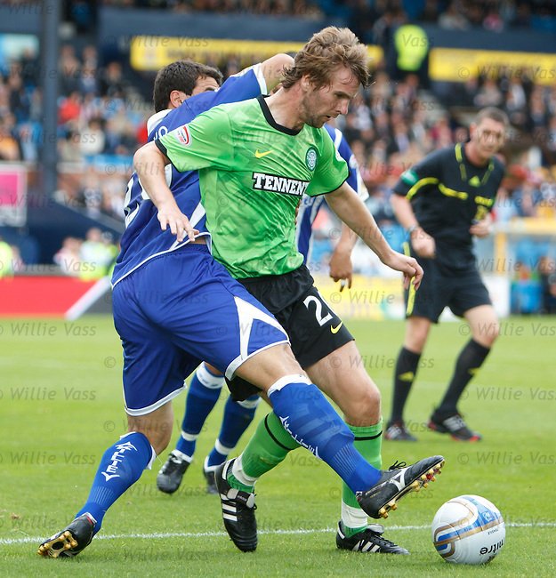Paddy McCourt turns past Tim Clancy and falls injuring his shoulder