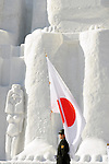 A member of Japan's Self Defense Forces prepares to hoist the national flag during the Sapporo Snow and Ice Festival in Sapporo City, northern Japan on Feb 4 2008. The SDF is charged with many of the duties involved in the festival, from trucking in pure white snow to building many of the sculptures on display.