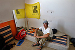 "Pinchas, 16, an ultra right-wing ""Kach"" activist, at his new room in a deserted hotel, which was taken-over by hardline West Bank Jewish settlers, in the Israeli settlement bloc of Gush Katif, Gaza Strip.<br /> The ""Palm Beach"" hotel was renamed to ""Ma'oz Hayam"", and is inhabited by a few dozens of settlers, who are ready to resist Israel's upcoming pullout from Gaza."
