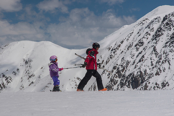 Parent and daughter at Arapahoe Basin Ski Area, Colorado, .  John leads private ski trips to Front Range and Summit County Ski Areas in Colorado.