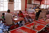 Guitar player singing in a traditional Mexican restaurant in the Mercado Pino Suarez market, Mazatlan, Sinaloa, Mexico