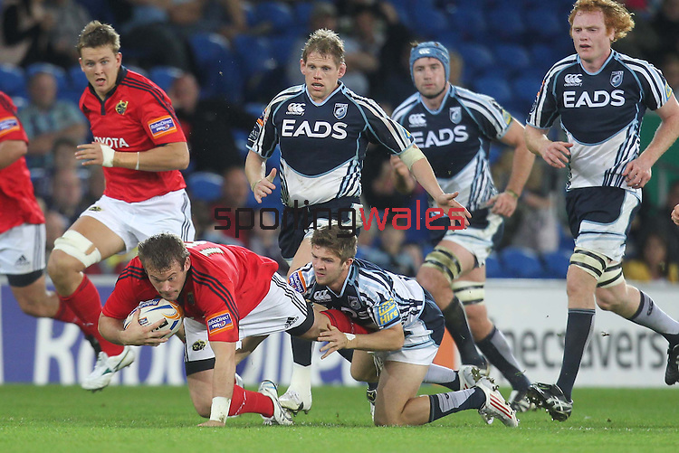 Rabo Direct Pro12.Cardiff Blues v Munster.Denis Fogarty scrambles forward with the ball as Lewis Jones and the Blues pack close in...23.09.11.©Steve Pope