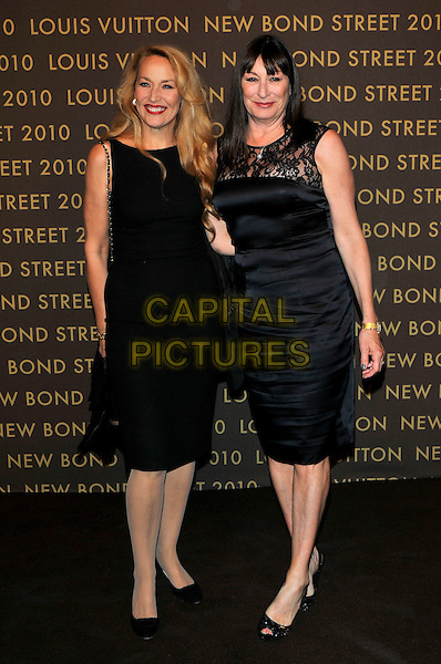 JERRY HALL & ANJELICA HUSTON attends the launch of the Louis Vuitton Bond Street Maison in London, England, UK, May 25th, 2010. .full length black sleeveless dress lace shift peep toe shoes patent.CAP/PL.©Phil Loftus/Capital Pictures.