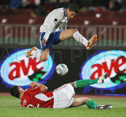 25 03 2011   Ibrahim Affelay White Jumps Over Zoltan Liptak during The European Championships Qualifier Game in Budapest between Hungary and The Netherlands men Football National team international match euro Qualif Euro Budapest