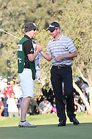 02/17/13 Pacific Palisades, CA: John Merrick and caddie Ryan Goble celebrate after winning the Northern Trust open on the second playoff hole.  t