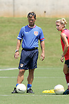 28 July 2006: Head Coach Greg Ryan (left) watches Aly Wagner (right) and the rest of the players on his team train. The United States Women's National Team trained at SAS Soccer Park in Cary, North Carolina, in preparation for an International Friendly match against Canada to be played on Sunday, July 30.