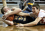 SIOUX FALLS, SD - FEBRUARY 1:  Brett Stanley #12 from Washington ties up Spencer Hanson #34 from Sioux Valley in the first quarter of their game Saturday afternoon at the Sanford Pentagon. (Photo by Dave Eggen/Inertia)