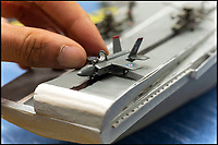 BNPS.co.uk (01202 558833)Pic: LeeMcLean/BNPS<br /> <br /> Each model, both ships and aircrafts, are hand made to a 1/300th scale by master matchstick modeller Philip Warren.<br /> <br /> Master modeller Philip Warren has spent 70 years building an incredible fleet of 484 warships and he says he is not ready to sail into the sunset.<br /> <br /> Philip, 87, has dedicated his entire adult life to crafting the matchstick armada and has built every class of ship in the Royal Navy since 1945, using over a million matchsticks.<br /> <br /> He recently completed a magnificent 3ft replica of the HMS Queen Elizabeth aircraft carrier which took him eight months.