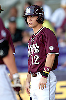 Mississippi State shortstop Adam Frazier #12 listens to the coaches instructions during the NCAA baseball game  against the LSU Tigers on March 17, 2012 at Alex Box Stadium in Baton Rouge, Louisiana. The 10th-ranked LSU Tigers beat #21 Mississippi State, 4-3. (Andrew Woolley / Four Seam Images).