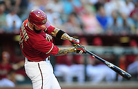 Jun. 6, 2012; Phoenix, AZ, USA; Arizona Diamondbacks third baseman Ryan Roberts hits a single in the first inning against the Colorado Rockies at Chase Field.  Mandatory Credit: Mark J. Rebilas-