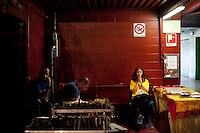 Milano: una donna di religione buddista durante la preghiera alla presenza del Dalai Lama Tenzin Gyatso..Milan: Buddhist woman during a prayer meeting with the Dalai Lama Tenzin Gyatso