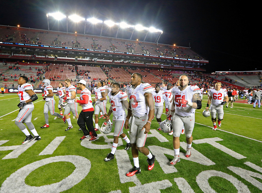 Ohio State Buckeyes walk to the northeast corner to celebrate with fans after beating Rutgers Scarlet Knights 49-7 at High Point Solutions Stadium on October 24, 2015.  (Dispatch photo by Kyle Robertson)