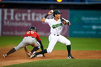 Jamestown Jammers second baseman Yefri Perez #18 attempts to turn a double play as D.J. Crumlich #29 slides in during the second game of a doubleheader against the State College Spikes at Russell Diethrick Park on August 30, 2012 in Jamestown, New York.  Jamestown defeated State College 2-1.  (Mike Janes/Four Seam Images)