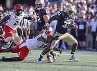 Annapolis, MD - September 23, 2017: Navy Midshipmen fullback Chris High (33) breaks a tackle during the game between Cincinnati and Navy at  Navy-Marine Corps Memorial Stadium in Annapolis, MD.   (Photo by Elliott Brown/Media Images International)