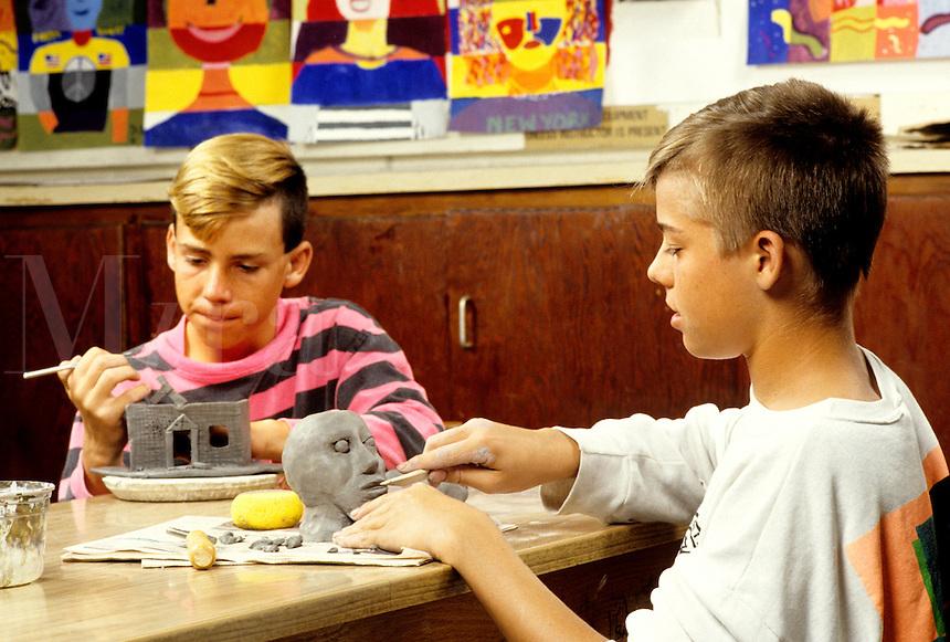 Students in grade 5 working on art project in schoo