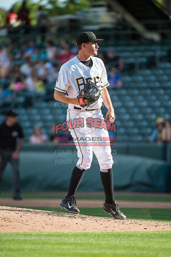 Salt Lake Bees starting pitcher Andrew Heaney (17) follows through on his delivery against the Albuquerque Isotopes in Pacific Coast League action at Smith's Ballpark on June 8, 2015 in Salt Lake City, Utah.  The Bees defeated the Isotopes 10-7 in game one of a double-header. (Stephen Smith/Four Seam Images)