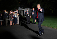 United States President Donald J. Trump waves to the press as he returns to The White House in Washington, DC after attending political events in Erie, Pennsylvania on Wednesday, October 10, 2018.<br /> Credit: Chris Kleponis / Pool via CNP /MediaPunch
