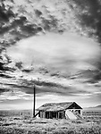 Abandoned house and storm, R C Ranch, Panorama Hills, Carrizo Plain National Monument, San Luis Obispo County, Calif.