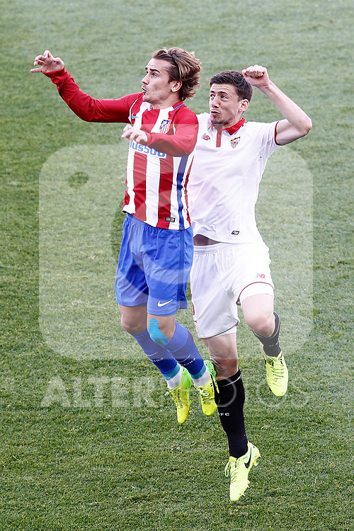 Atletico de Madrid's Antoine Griezmann (l) and Sevilla FC's Clement Lenglet during La Liga match. March 19,2017. (ALTERPHOTOS/Acero)