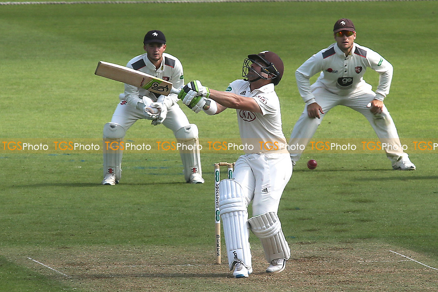 Surrey's Dean Elgar takes a blow to his body after missing the ball with an attempted hook shot during Surrey CCC vs Kent CCC, Specsavers County Championship Division 1 Cricket at the Kia Oval on 7th July 2019