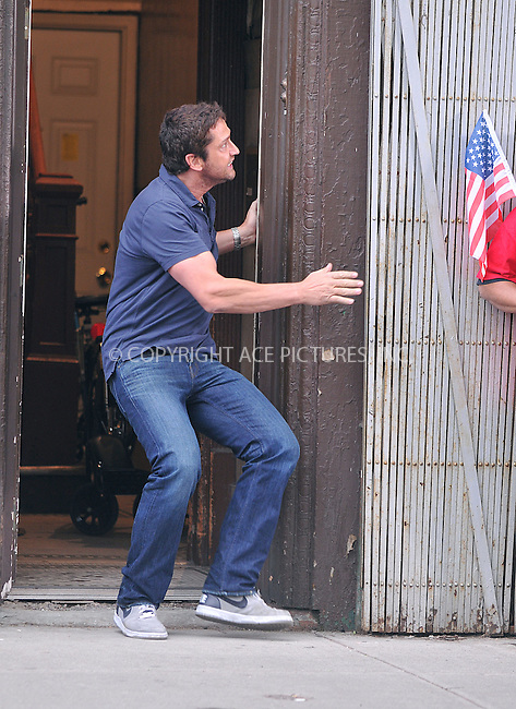 WWW.ACEPIXS.COM . . . . .  ....June 17 2009, New York City....Actor Gerald Butler was on the Brooklyn set of the new movie  'The Bounty' on June 17 2009 in New York City. In one scene Butler knocks a stilt-walker to the ground.....Please byline: AJ Sokalner - ACEPIXS.COM..... *** ***..Ace Pictures, Inc:  ..tel: (212) 243 8787..e-mail: info@acepixs.com..web: http://www.acepixs.com