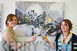 Cheers to You!: At the official opening of their art exhibition in the Cahersiveen Library on Thursday night were, from left: Martha OConner (Foilmore) and Carolyn Walsh (Renard). This exhibition is running until Thursday 26th of April and can be viewed in the Cahersiveen Library. .