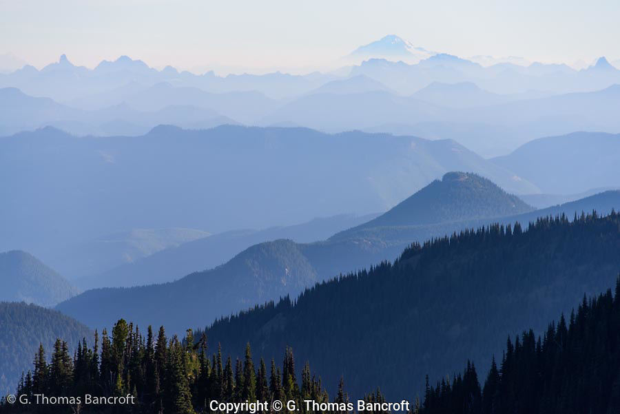 Mt Baker rises above the Cascades north of Mt Rainier. The photograph was taken from Sourdough Ridge in Mt Raineir national Park.