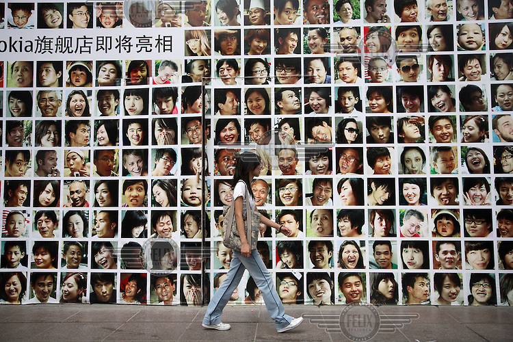 A pedestrian walks past a Nokia store under renovation in Shanghai.
