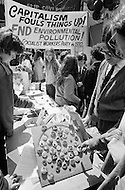 "New York City, NY, 22 Apr 1970 --- Pedestrians walk past a demonstrator who is sitting in the middle of the street inside a chalk circle with the message ""Please don't hit the pedestrian"" pointing at him. Various public demonstrations and rallies are taking place around New York City during the first Earth Day."