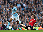 Raheem Sterling of Manchester City skips over the tackle mace by Ander Herrera of Manchester United during the premier league match at the Etihad Stadium, Manchester. Picture date 7th April 2018. Picture credit should read: Simon Bellis/Sportimage