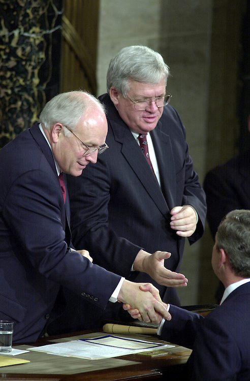 13joint022701 --President Bush shakes the hands of Vice President Cheney and Speaker of the House J. Dennis Hastert, R-Ill., after his address to the Joint Session of Congress.