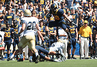 Eric Stevens leaps over his defenders. The University of California Berkeley Golden Bears defeated the UC Davis Aggies 52-3 in their home opener at Memorial Stadium in Berkeley, California on September 4th, 2010.