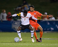 Amadou Dia (11) of Clemson fights for the ball with Christiano Francois (3) of Maryland during the game at the Maryland SoccerPlex in Germantown, MD. Maryland defeated Clemson, 1-0, in overtime.  With the win the Terrapins advanced to the finals of the ACC men's soccer tournament.