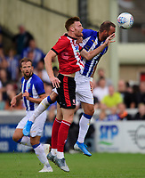 Lincoln City's Cian Bolger vies for possession with Sheffield Wednesday's Steven Fletcher<br /> <br /> Photographer Chris Vaughan/CameraSport<br /> <br /> Football Pre-Season Friendly - Lincoln City v Sheffield Wednesday - Saturday July 13th 2019 - Sincil Bank - Lincoln<br /> <br /> World Copyright © 2019 CameraSport. All rights reserved. 43 Linden Ave. Countesthorpe. Leicester. England. LE8 5PG - Tel: +44 (0) 116 277 4147 - admin@camerasport.com - www.camerasport.com