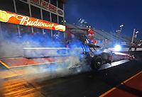 Jan 25, 2009; Chandler, AZ, USA; NHRA top fuel dragster driver Brandon Bernstein does a burnout during testing at the National Time Trials at Firebird International Raceway. Mandatory Credit: Mark J. Rebilas-