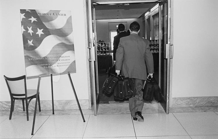 Loaded down with laptops, staffers make the delivery to the service centers in Rayburn House Office Building cafeteria converted to a temporary 'Break Out' area for new members on Nov. 29, 1994. (Photo by Maureen Keating/CQ Roll Call via Getty Images)