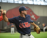 NWA Democrat-Gazette/ANDY SHUPE<br /> Ole Miss infielder Jacob Adams warms up Friday, June 7, 2019, during practice in The Fowler Family Baseball and Track Training Center ahead of today's NCAA Super Regional game at Baum-Walker Stadium in Fayetteville. Visit nwadg.com/photos to see more photographs from the practices.