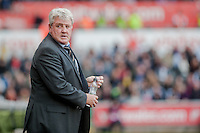 SWANSEA, WALES - APRIL 04: Manager of Hull City, Steve Bruce  on the sidelines during the Premier League match between Swansea City and Hull City at Liberty Stadium on April 04, 2015 in Swansea, Wales.  (photo by Athena Pictures)