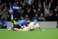 Jack Nowell of England scores his second try past Rory Kockott of France