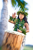"A Hawaiian woman in kahiko attire plays her pahu (drum) Kanileo, or ""The Voice,"" O'ahu."