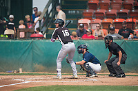 Grand Junction Rockies right fielder Niko Decolati (16) at bat in front of catcher David Fry (5) and home plate umpire John Perez during a Pioneer League game against the Helena Brewers at Kindrick Legion Field on August 19, 2018 in Helena, Montana. The Grand Junction Rockies defeated the Helena Brewers by a score of 6-1. (Zachary Lucy/Four Seam Images)