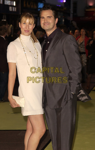 "KAROLINE COPPING & JIMMY CARR.Arrivals at the World Premiere of ""Alien Autopsy"", .Odeon Leicester Square, London, .England, April 3rd 2006..half length couple white cream polo neck sweater dress clutch bag necklace beads.Ref: CAN.www.capitalpictures.com.sales@capitalpictures.com.©Can Nguyen/Capital Pictures"