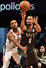 Spencer Dinwiddle #8 of the Brooklyn Nets, right, passes away from Mikal Bridges #25 of the Phoenix Suns during an NBA game at the Barclays Center in Brooklyn, NY on Sunday, Dec. 23, 2018. Dinwiddle scored a team-high 24 points to lead the Nets to a 111-103 win.