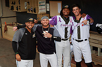 "Akron RubberDucks Gianpaul Gonzalez, Alexis Pantoja, Oscar Gonzalez (38), and Nolan Jones (17) before an Eastern League game against the Erie SeaWolves on August 30, 2019 at Canal Park in Akron, Ohio.  Akron wore special jerseys with the slogan ""Fight Like a Kid"" during the game for Akron Children's Hospital Home Run for Life event, the design was created by 11 year old Macy Carmichael.  Erie defeated Akron 3-2.  (Mike Janes/Four Seam Images)"