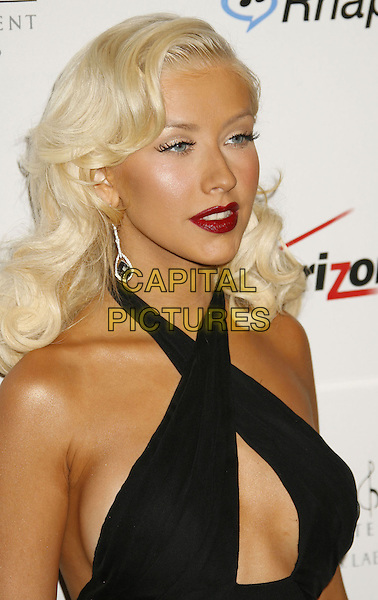CHRISTINA AGUILERA.Clive Davis 2007 Pre-Grammy Awards Party held at the Beverly Hilton Hotel, Beverly Hills, California, USA..February 10th, 2007.headshot portrait black halterneck peephole cut out red lipstick cleavage dangling earrings .CAP/ADM/RE.©Russ Elliot/AdMedia/Capital Pictures