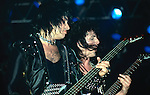 Gene Simmons & Mark St John of Kiss performing live in Poughkeepsie , NY - Nov 1984